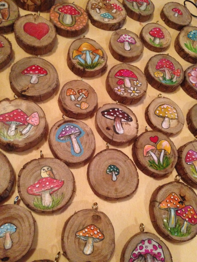 little hand painted mushroom pendants made from fallen tree branches..$20 each plus postage